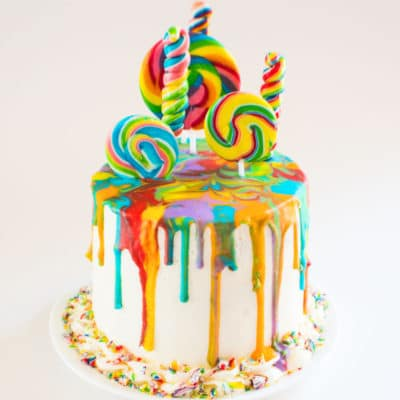 Rainbow Lollipop Drip Cake, 6 inch round 4 layer vanilla cake with royal icing drip and rainbow lollipops