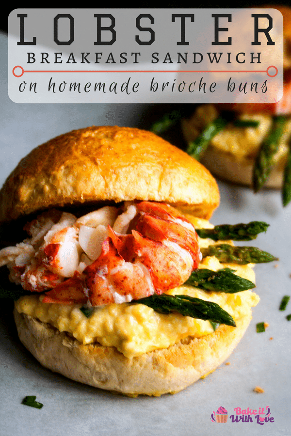 An amazing Lobster Breakfast Sandwich piled high with creamy scrambled eggs, asparagus spears and lobster on a fresh brioche sandwich bun!