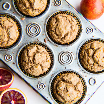 Easy, one-bowl method whole wheat blood orange muffins using organic, non-refined sugar and applesauce for sweetness!