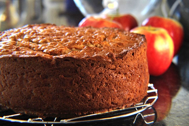 Our delicious Irish Apple Cake freshly baked and out of the oven, set on a wire cooling rack to cool completely.