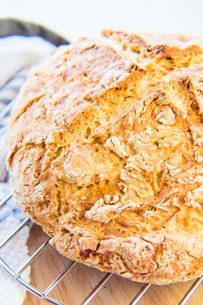 Traditional Irish Soda Bread round loaf baked perfectly and cooling.