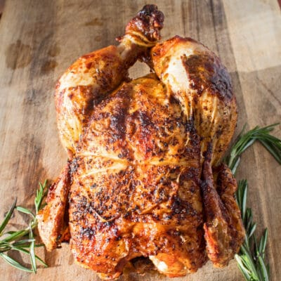 This Air Fryer Rotisserie Chicken recipe makes it easy to get that delicious grocery store deli rotisserie chicken flavor at home!